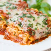 A close up of lasagna roll ups on a plate