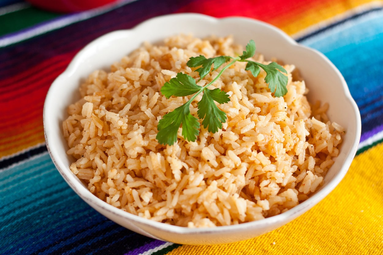 Mexican Rice garnished with parsley in a white bowl