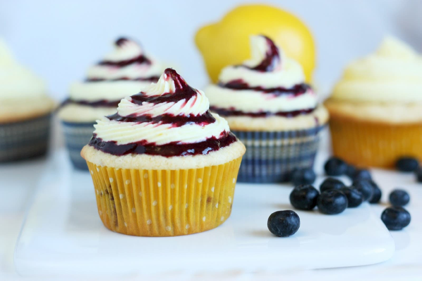 Blueberry Cupcakes with Lemon Buttercream Frosting and Blueberry Sauce ...