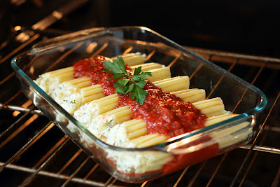 Homemade Manicotti In Oven Stuffed With Filling