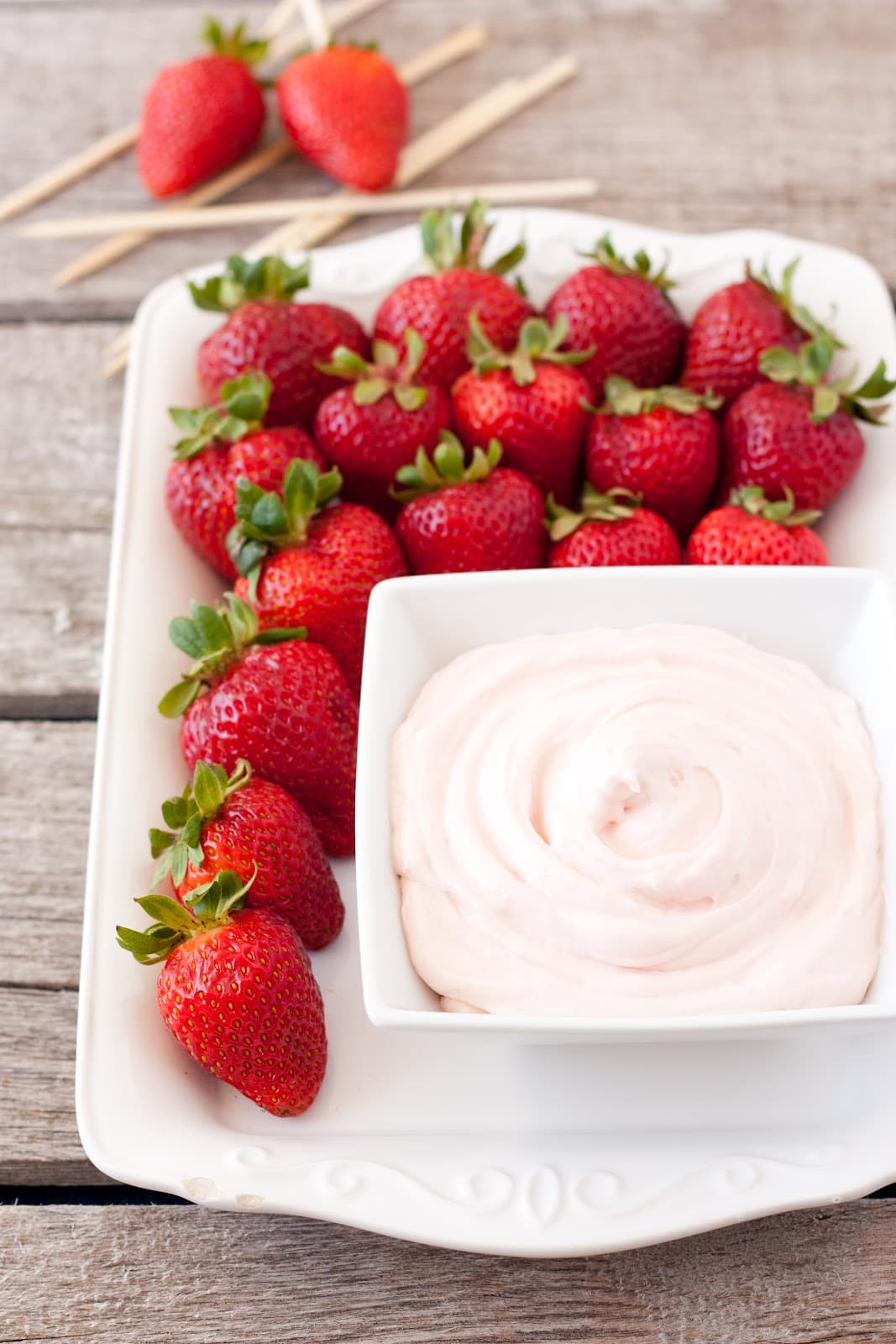 Strawberry Fruit Dip on platter with fresh strawberries