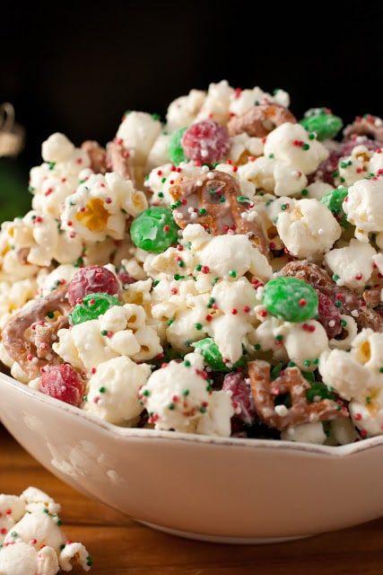 A side shot of Christmas crunch funfetti popcorn in a bowl