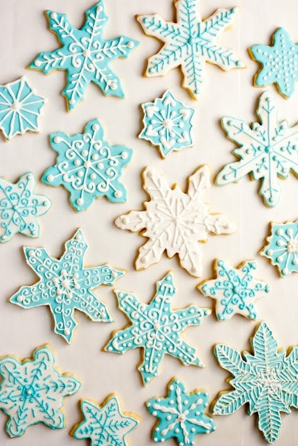 Iced Sugar Cookies cut into snowflake shapes.