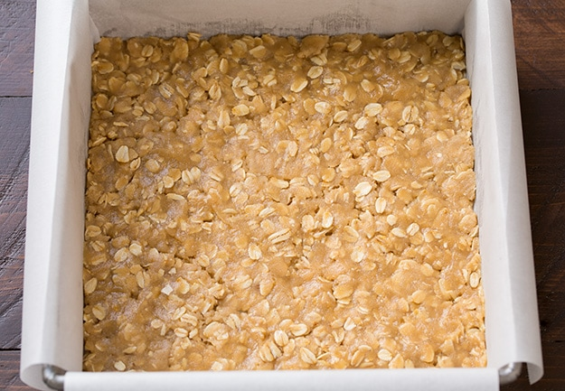 uncooked Salted Carmelitas base layer in baking dish