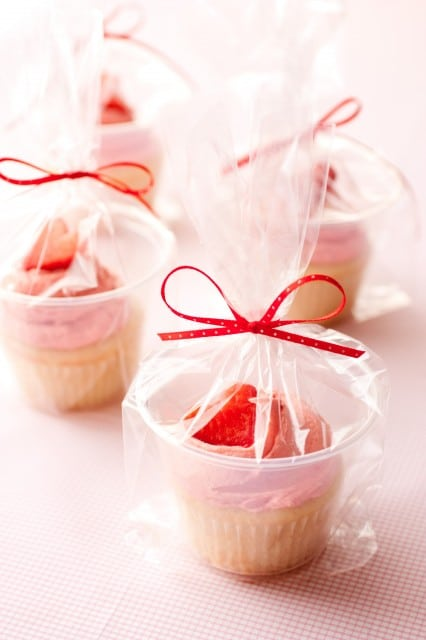 Strawberry Shortcake Cupcakes wrapped in cellophane ready to be gifted