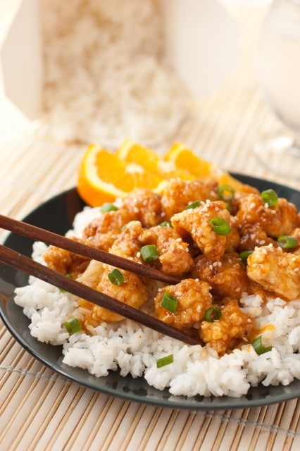 chinese orange chicken with chopsticks on plate