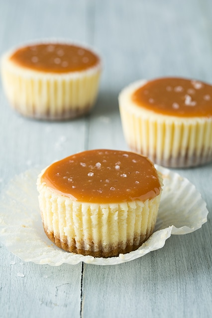 Salted Caramel Cheesecake Cupcakes with an open wrapper