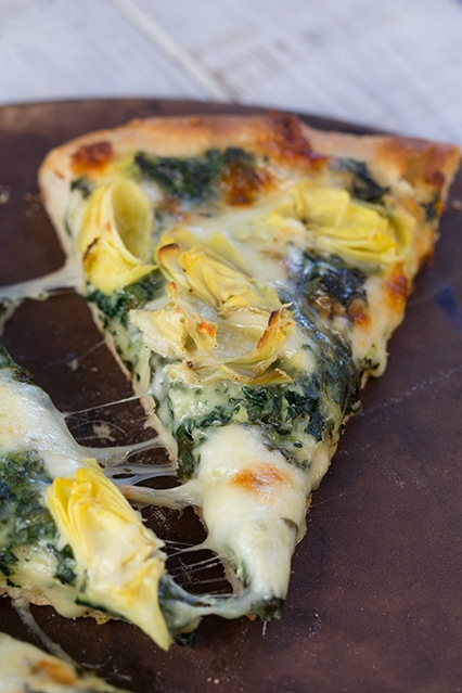 Melted Cheesy Spinach Artichoke Pizza slice
