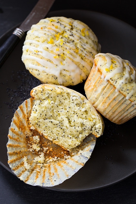 three Lemon Poppyseed Muffins on plate with knife