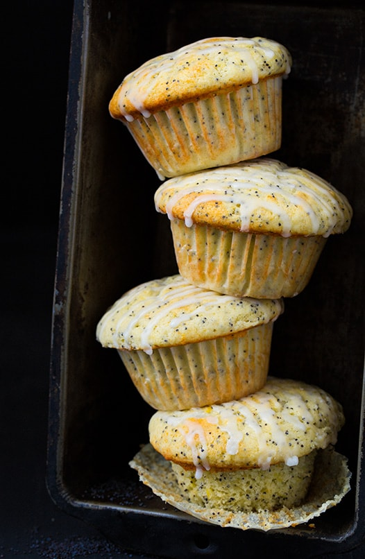 four Lemon Poppyseed Muffins stacked in baking dish