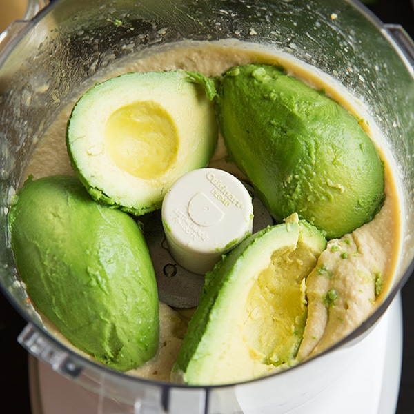 A process shot of making avocado hummus