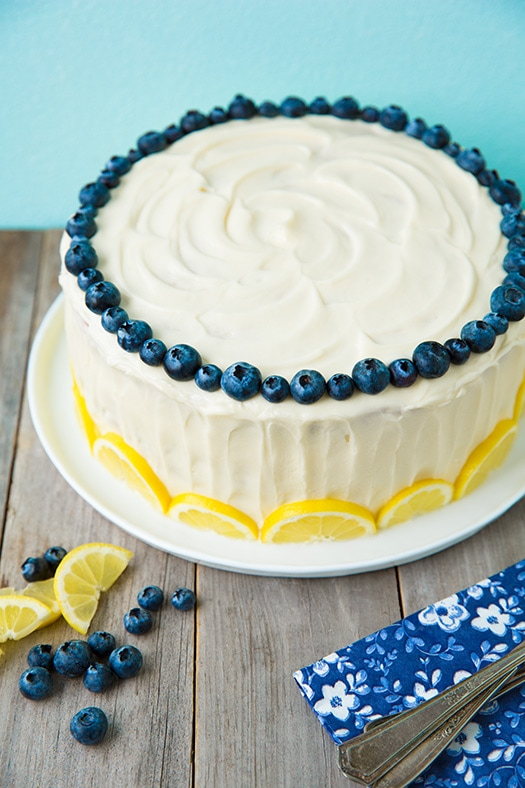 Lemon Blueberry Cake garnished with lemon slices and fresh blueberries