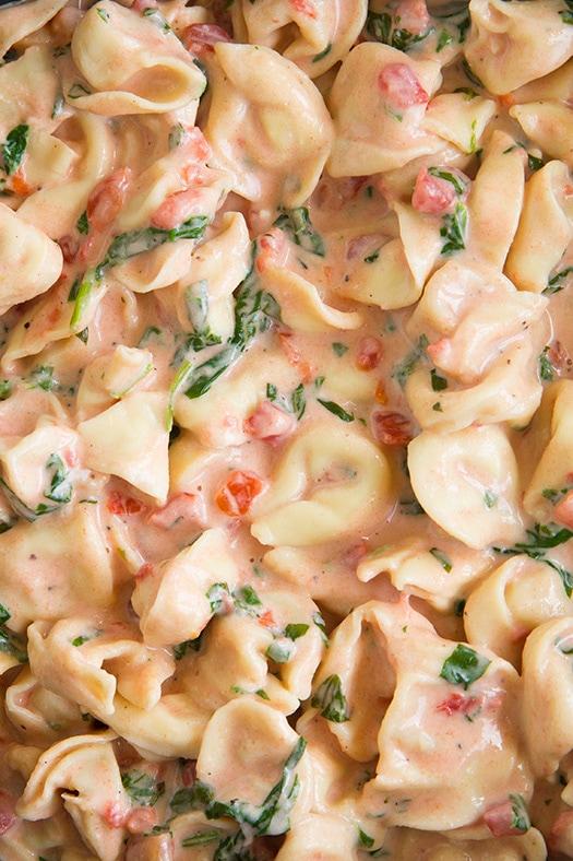 A close up of Creamy Spinach Tomato Tortellini