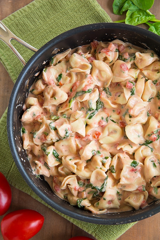 Creamy Spinach Tomato Tortellini in a skillet pan