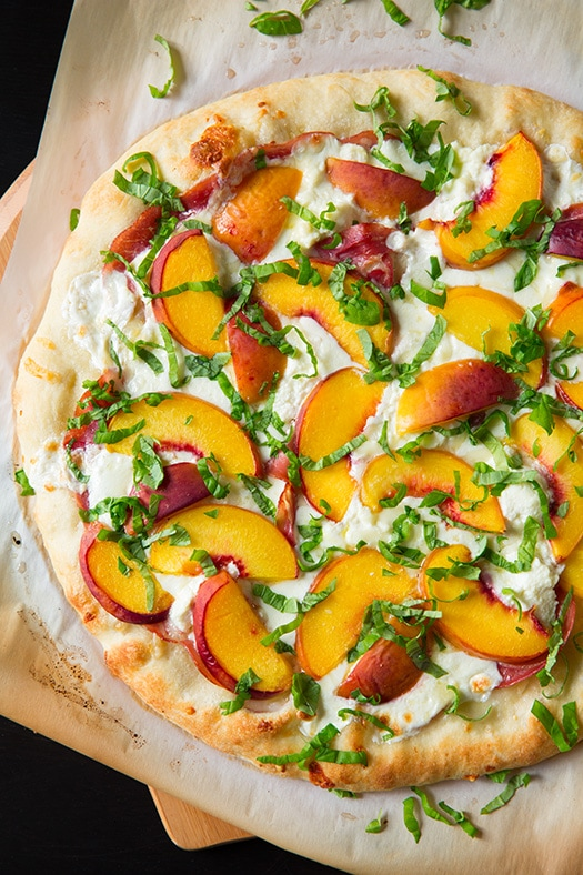 Peach and Prosciutto Pizza garnished with fresh basil