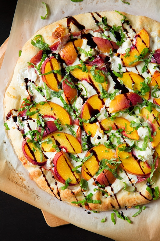 Peach and Prosciutto Pizza drizzled with balsamic reduction