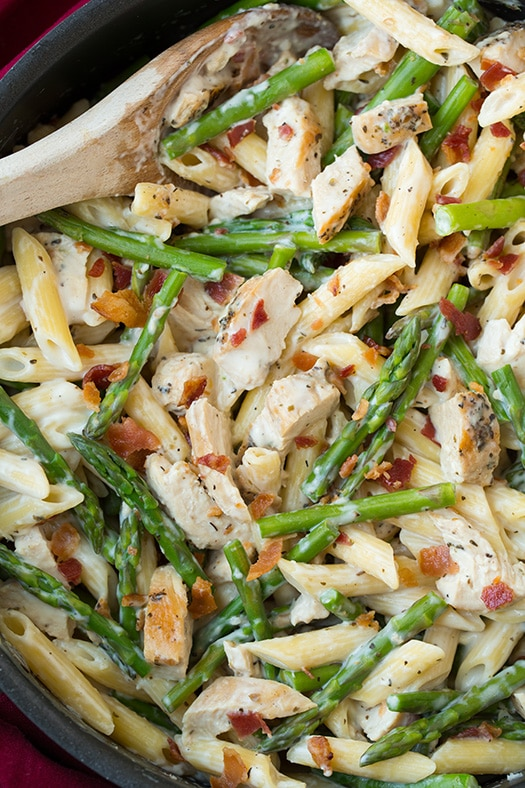 Chicken Asparagus Pasta in skillet with wooden spoon