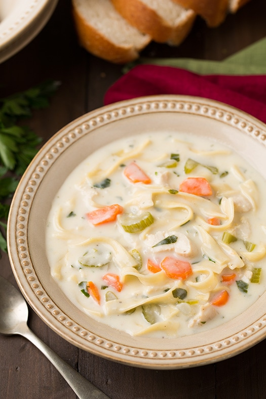 Creamy Chicken Noodle Soup in a bowl with a spoon