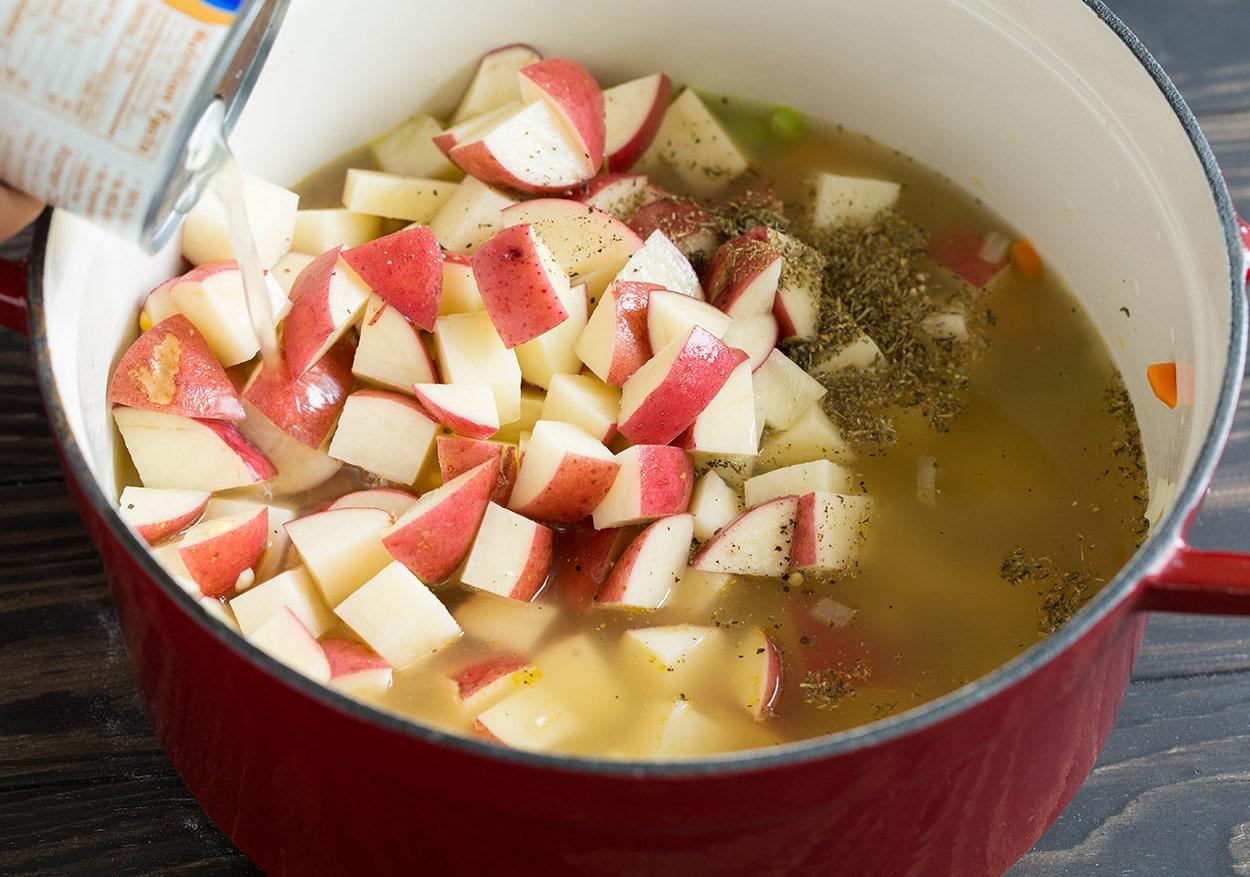 Creamy Ham Potato Corn Chowder adding potatoes broth herbs