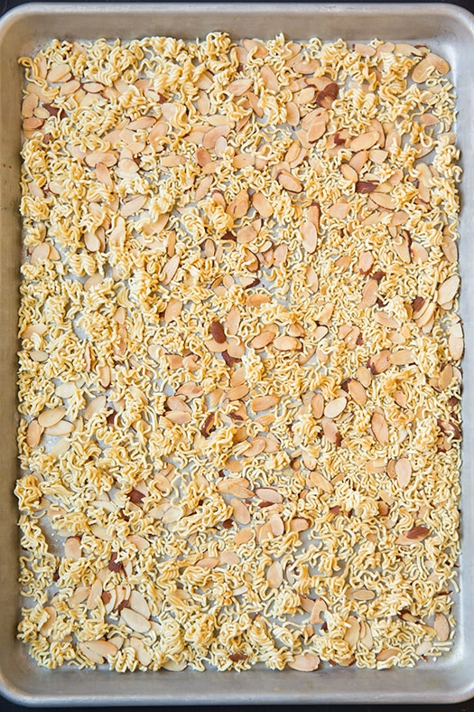 ramen noodles and slivered almonds on baking tray