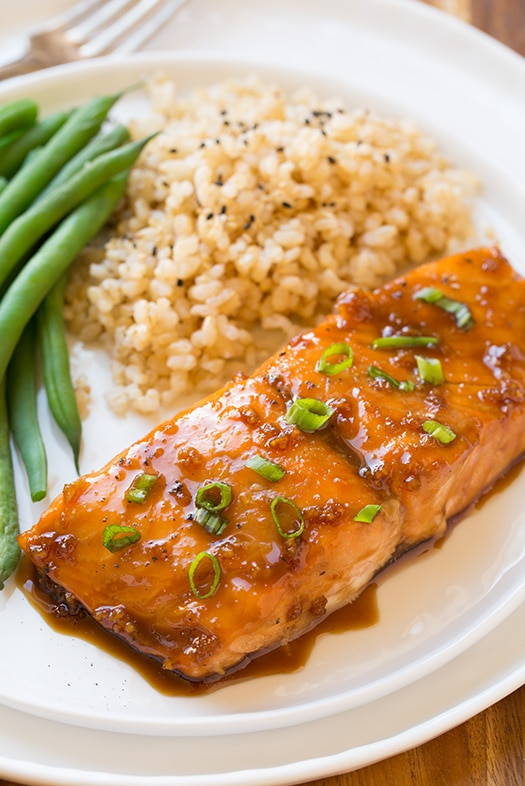 soy maple glazed salmon with rice and green beans on white plate
