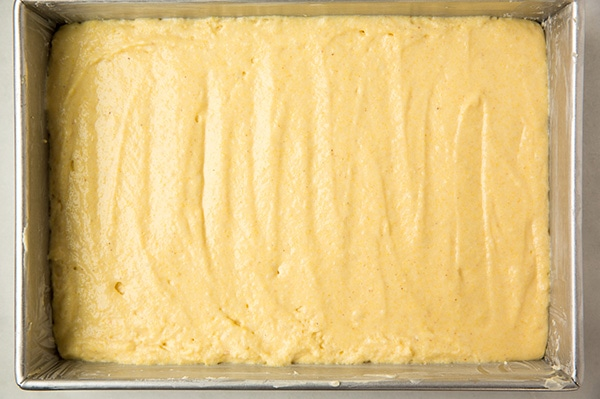 Cornbread batter made from easy cornbread recipe in pan ready to bake