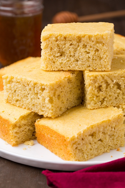 The Best Cornbread squares piled high on a plate