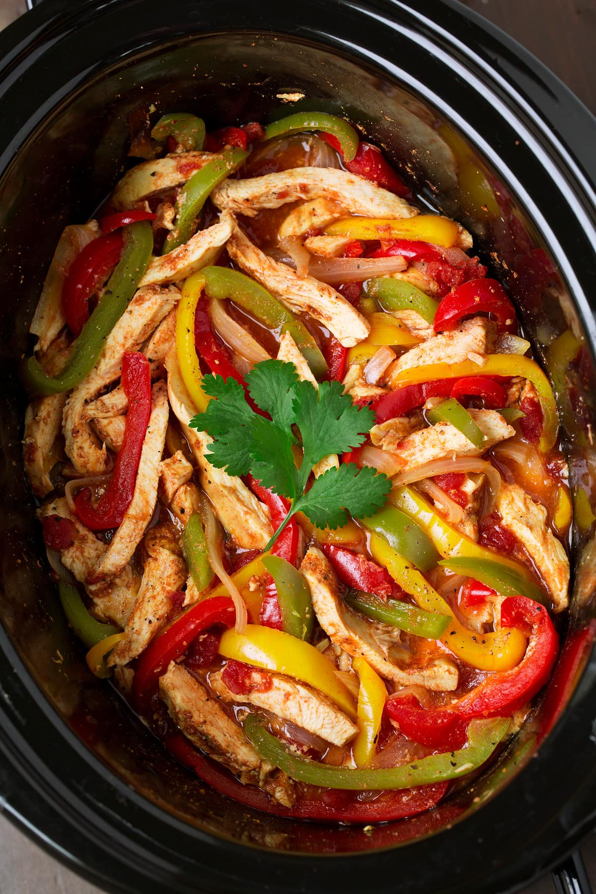 Crockpot Chicken Fajitas shown in a slow cooker.
