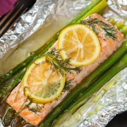 A close up of salmon and asparagus in foil