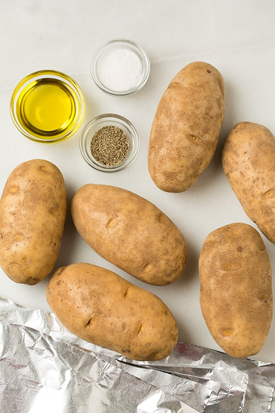 Ingredients for slow cooker baked potatoes shown here.