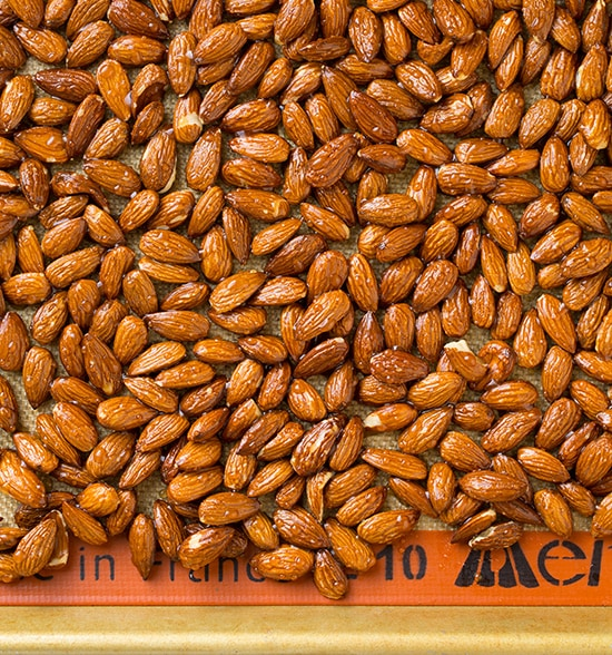 roasted almonds on baking sheet
