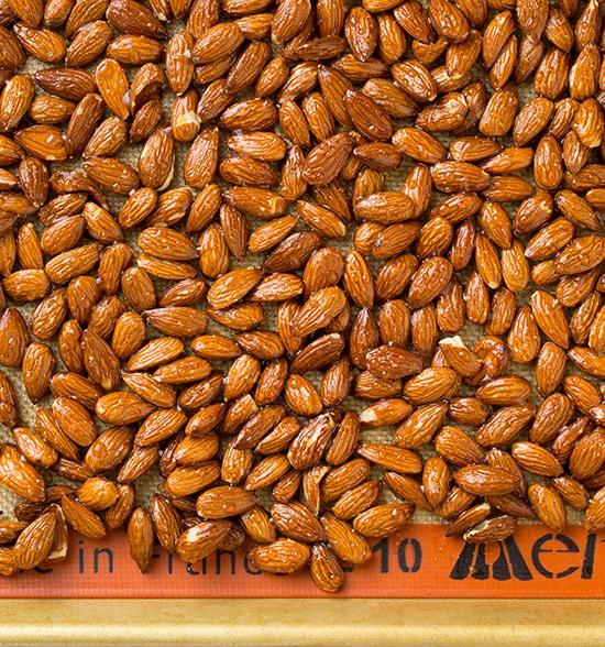 roasted almonds on baking sheet