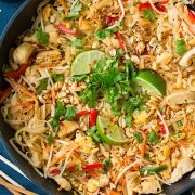 A close up of chicken pad thai in a pan