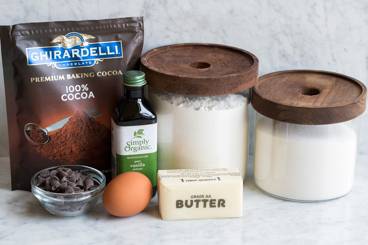 Ingredients for small batch brownies displayed. Includes flour, sugar, butter, vanilla, egg, cocoa powder and optional chocolate chips.