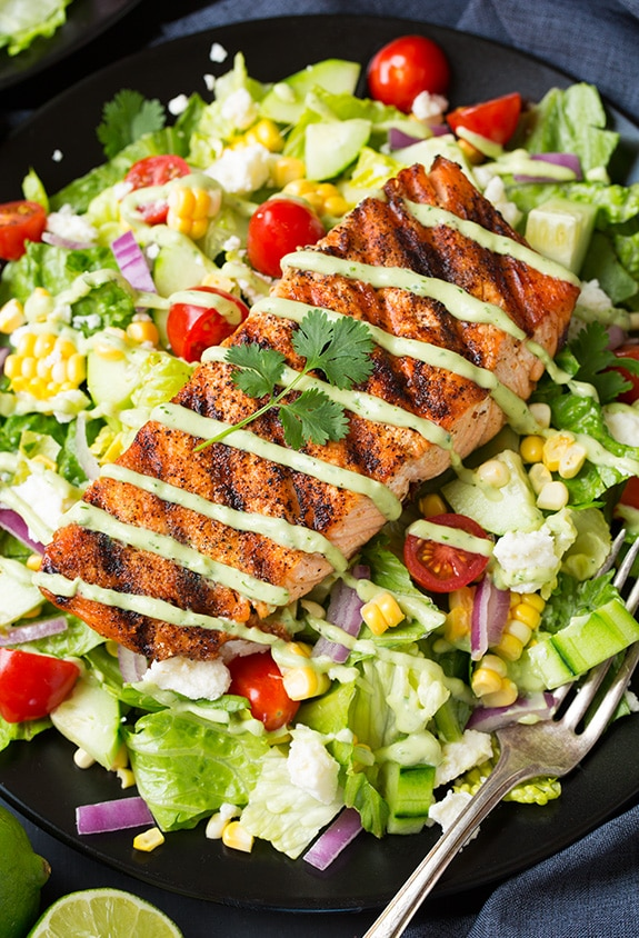Mexican Grilled Salmon Salad in dark bowl with fork