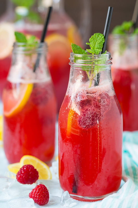 Sparkling Raspberry Lemonade in glass jars with plastic straws