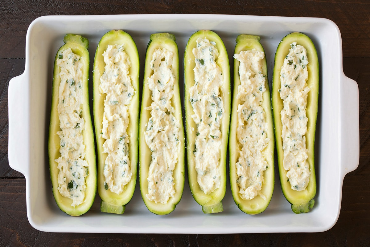 Cheese mixture layered into lasagna zucchini boats.