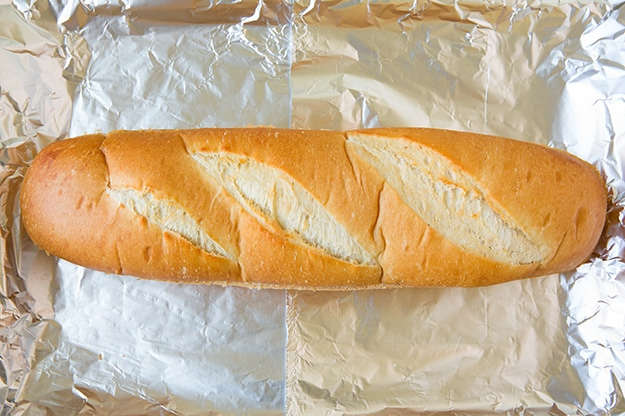 French bread loaf on foil