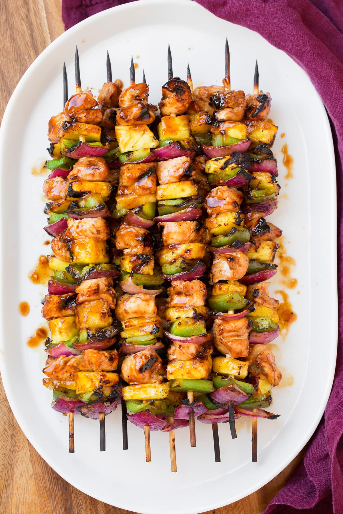 Stack of chicken skewers on a plate.