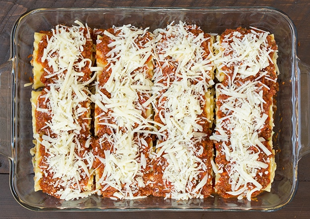 Mozzarella cheese sprinkled on top of Lasagna Roll Ups