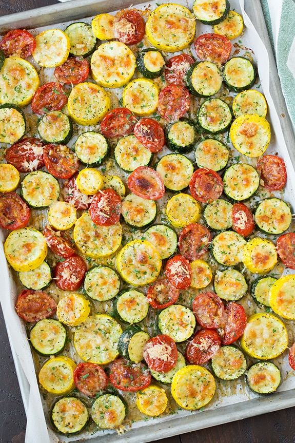 An overhead shot of roasted Zucchini, Squash and Tomatoes in a baking tray