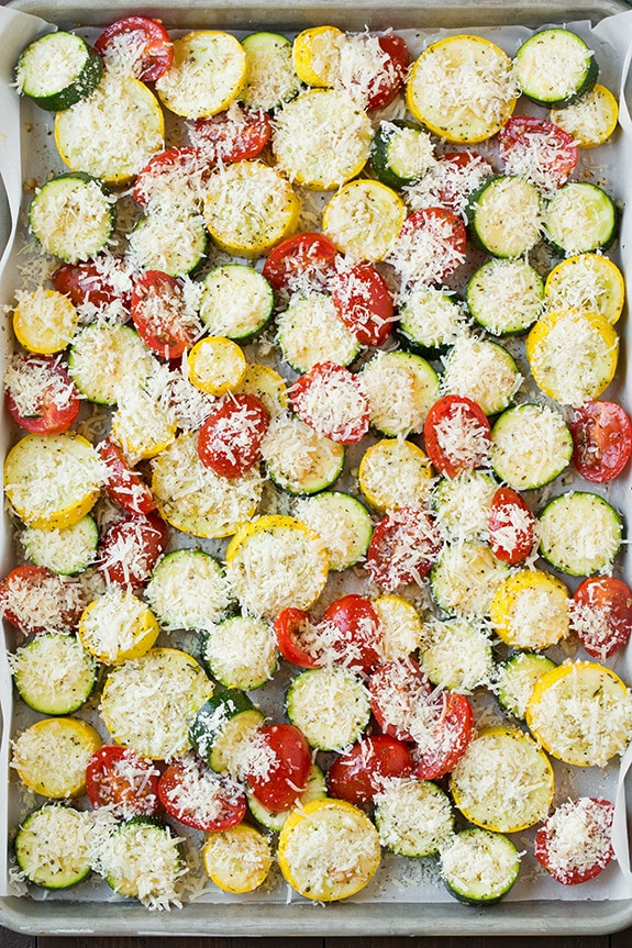 Zucchini, Squash and Tomatoes on a sheet pan ready to be roasted