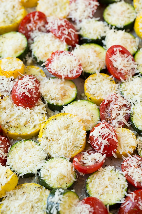 A close up of Zucchini, Squash and Tomatoes topped with parmesan cheese