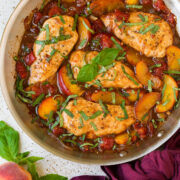 Peach chicken in a skillet.