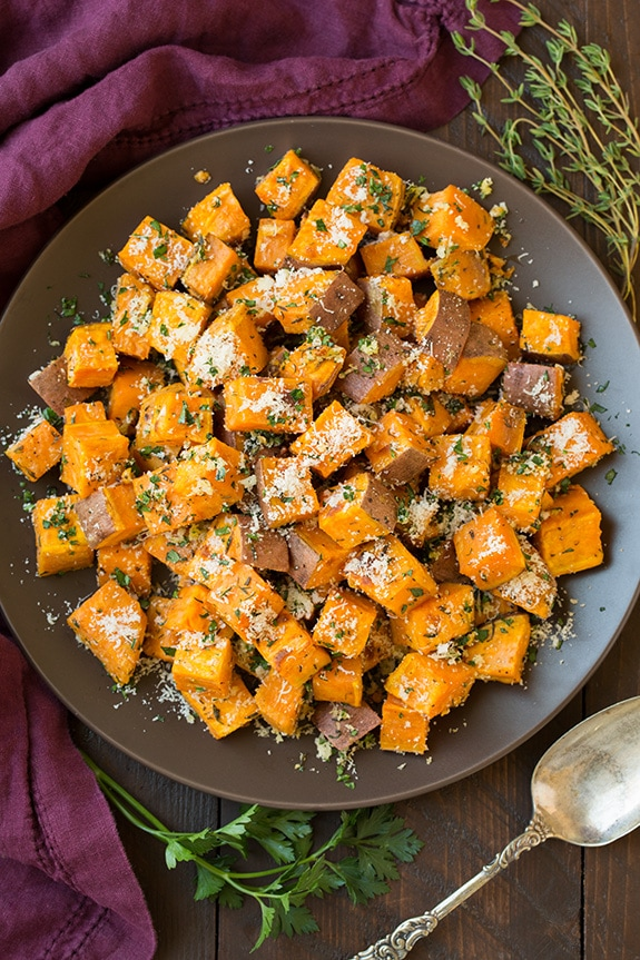 Savory Roasted Sweet Potatoes with Parmesan, Garlic & Herbs on a plate