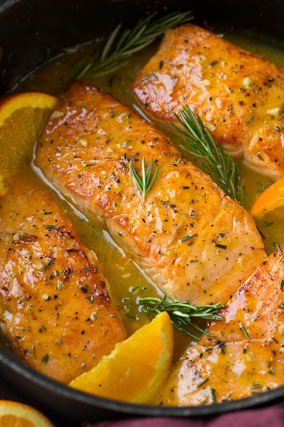 Salmon Recipe with rosemary and orange cooking in skillet