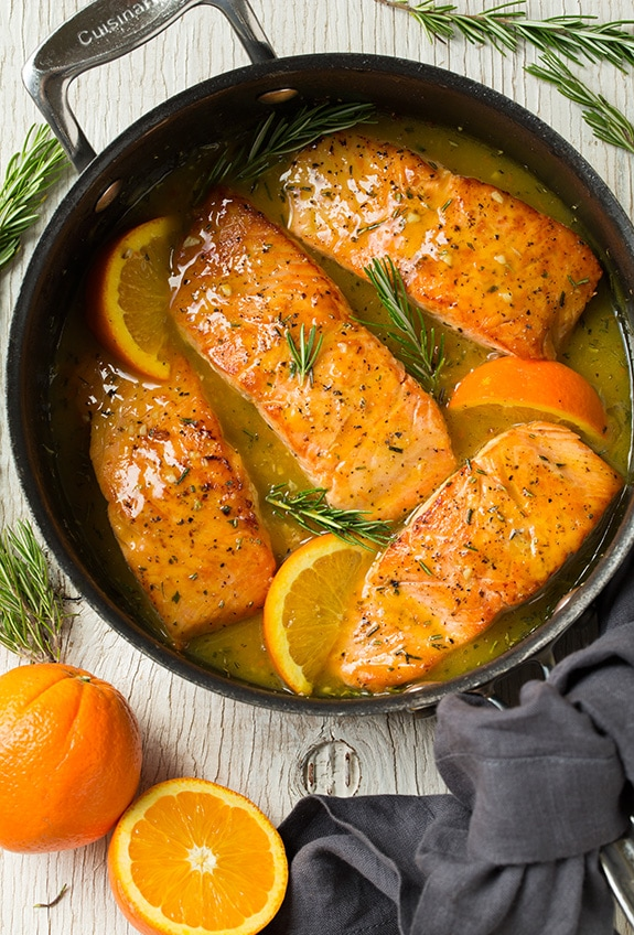 Orange Glazed Salmon with Rosemary Cooking In Skillet