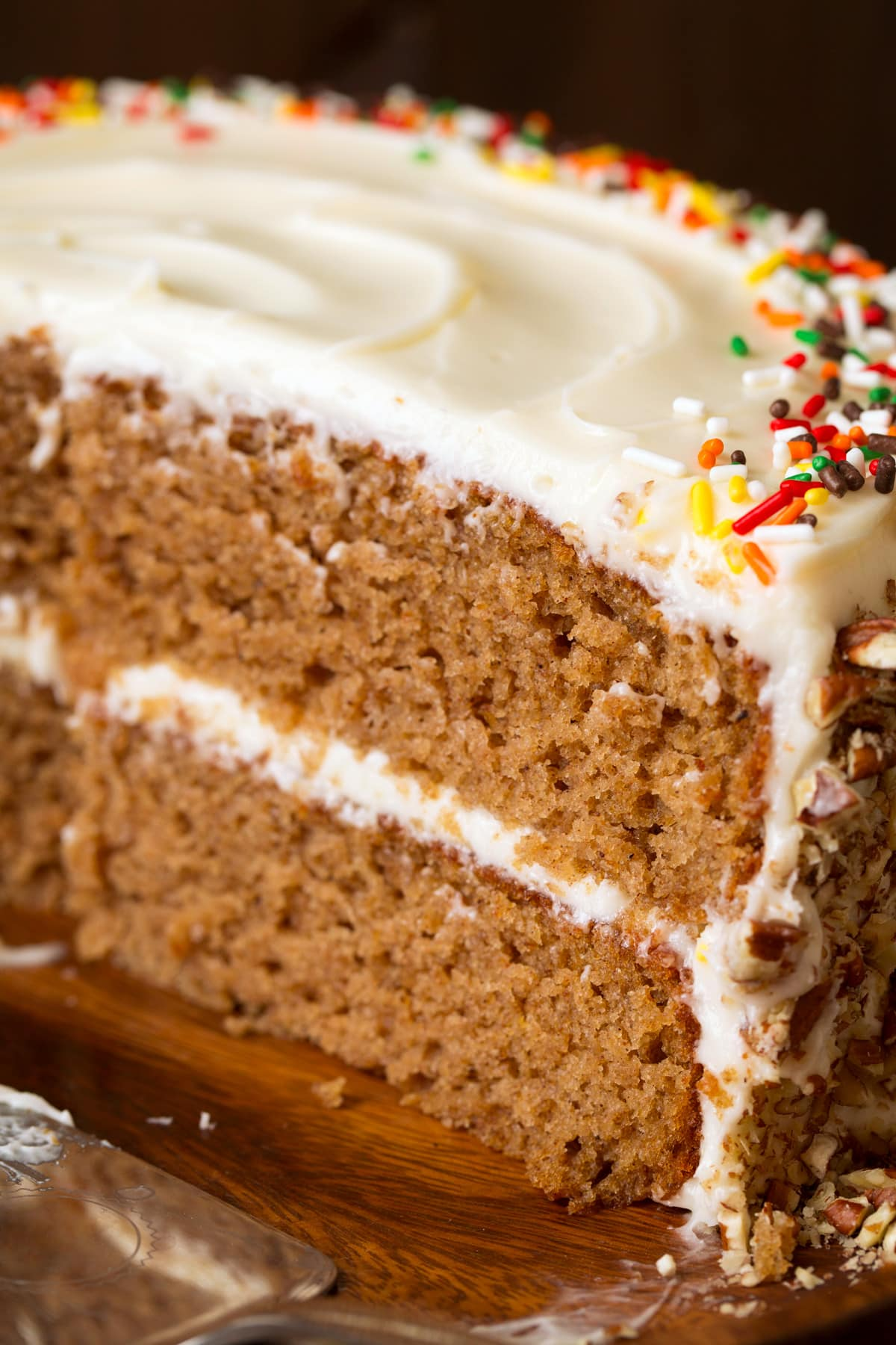 Close up image of spice cake showing texture and frosting layers.