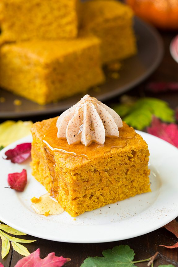 Slice of pumpkin cornbread topped with piped cinnamon honey butter.