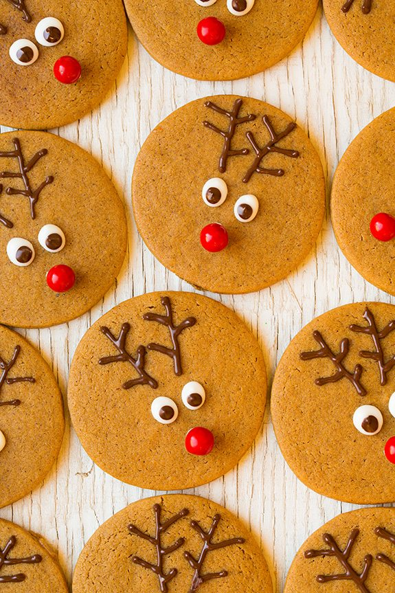 Gingerbread cookies cut into rounds then decorated as reindeer faces.